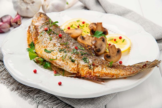 Delicate fish with lemon juice and italian herbs
